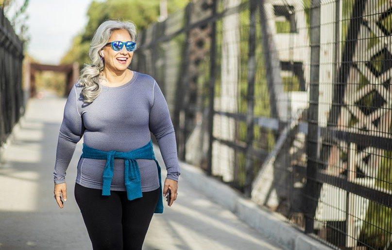 Blog seasonal affective disorder woman walking outside GettyImages 1188769671