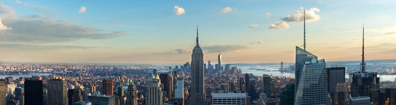 View of New York skyline with blue skies.