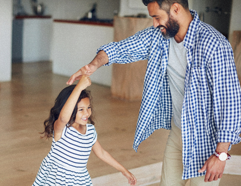 father dances with her child